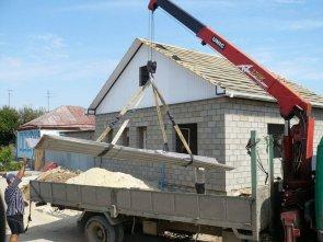 Необходимость манипулятора при строительстве частного дома